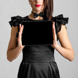 Business woman holding and shows touch screen tablet pc with blank screen Stock Image