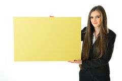 Business Woman Holding Sign. Business woman holding a blank yellow board that can be filled in with metaphors and concepts Stock Image