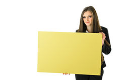Business Woman Holding Sign. Business woman holding a blank yellow board that can be filled in with metaphors and concepts Royalty Free Stock Image