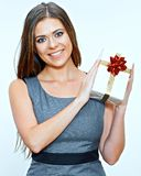 Business woman holding small gift box. Isolated studio portrait of happy female office worker Stock Image