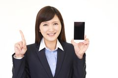 Woman with a smart phone. Business woman holding a smart phone stock photos