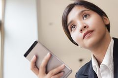 Business woman holding smartphone in her hand. stock photos