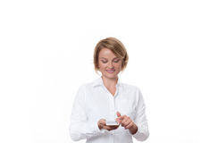 Business woman holding smartphone on white background. Portrait of business woman holding smartphone on white background stock photo