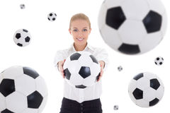 Business woman holding soccer ball over white background with fl. Beautiful business woman holding soccer ball over white background with flying leather balls stock photo
