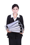 Business woman holding stack of folders documents isolated on wh Stock Photo