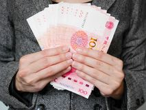 Free Business Woman Holding Stack Of 100 Yuan Banknotes Royalty Free Stock Photos - 161282378