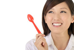 Business woman holding tablespoon Stock Photos