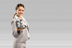 Business woman holding a tablet with british pound Stock Photos