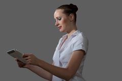Business woman holding a tablet computer Royalty Free Stock Image