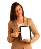 Business woman holding a tablet computer - isolated over a white Royalty Free Stock Images