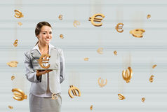 Business woman holding a tablet with euro Stock Images