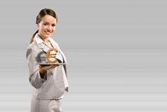 Business woman holding a tablet with euro Stock Image