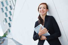 Business woman holding tablet pc Stock Photography