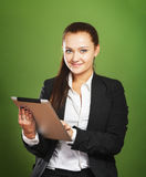Business woman holding tablet pc on green background Stock Photos