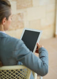 Business woman holding tablet PC. Rear view Stock Image