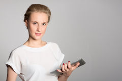 Business woman holding a tablet PC Royalty Free Stock Images