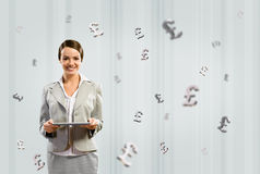 Business woman holding a tablet and smile Royalty Free Stock Images