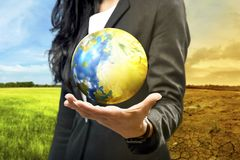 Free Business Woman Holding The Earth Royalty Free Stock Photo - 135604575