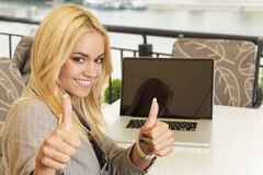 Business woman holding thumbs up Stock Images