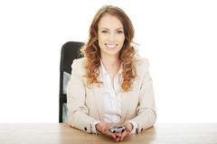 Business woman holding a toy car. Stock Images