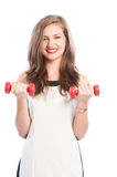 Business woman holding two small weights Stock Images