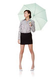 Business woman holding umbrella Stock Image