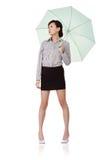 Business woman holding umbrella Stock Image