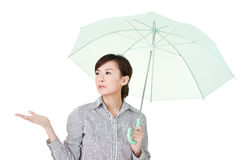 Business woman holding umbrella Stock Images