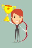 Business woman holding up winning trophy and bow. Stock Photos