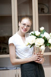 Business woman holding a vase with white peonies. Royalty Free Stock Photography