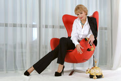 Business woman is holding a vintage phone handset Royalty Free Stock Images