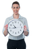 Business woman holding wall clock Stock Images