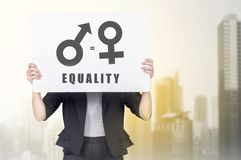 Business woman holding white banner with equality of gender symbol. Equality gender concept royalty free stock image