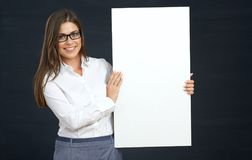 Business woman holding white board show teeth with smile. White shirt Royalty Free Stock Photos