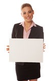 Business woman holding a white card Stock Photo