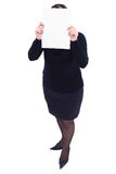 Business woman holding a white panel in front of her face in the Royalty Free Stock Images