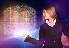 Business woman holding a wireframe house on the Stock Photo