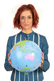 Business woman holding world globe Stock Images