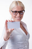 Business woman holds a business card Royalty Free Stock Images