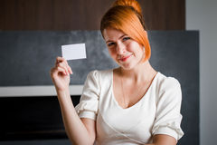 Business woman holds a business card inside the office Royalty Free Stock Photos