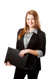 Business woman holds clipboard. Young business woman looking at camera and holds clipboard Royalty Free Stock Photography