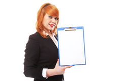 Business woman holds clipboard and points Royalty Free Stock Images