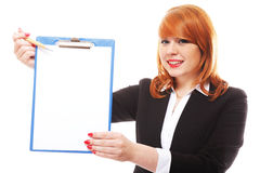Business woman holds clipboard and points Royalty Free Stock Photo