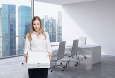 Business woman holds a couple of pizza boxes. Royalty Free Stock Photography