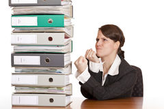 Business woman holds fists to file folder stack Stock Images