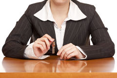 Business woman holds house key for handing over Royalty Free Stock Photography