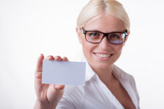 Business woman holds out a business card Stock Image