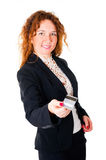 Business woman holds out her credit card Stock Images