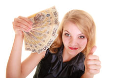 Business woman holds polish money giving thumb up Stock Photos
