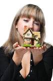 The business woman holds the small house Stock Photo